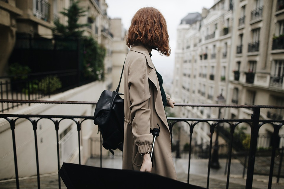 girl on the street while holding an umbrella in paris